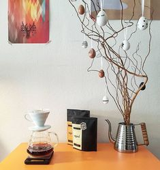 # @mostlyfilter   Great looking coffee corner.   == #KaffeBox Member Post == Just received this month's @kaffebox!! The Ethiopia Banko of @aprilcoffeecph is incredible!!!  - Also we got these early Easter decorations but Vakum is already trying to destroy them so I wanted to post them before they are gone haha