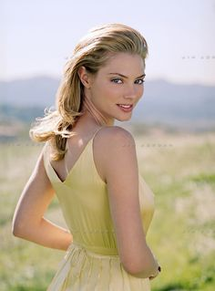 Girl Looking Back Over Shoulder | young woman in a yellow dress standing in a field looking back over ...