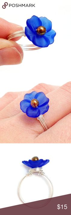 Royal Blue Lucite Flower Wire Wrapped Ring A cobalt blue flower sits on a bed of wire. Made with a 14mm blue resin flower, a 4mm glass bead, and silver plated non-tarnish wire. The wire is nickel-free and won't leave black marks around your finger. Held together by nothing but wire; no glue has been used. Choose your own color for the bead in the center of the flower - the ones I have available are shown in the last photo. Just comment if you'd like a color other than topaz for the center…