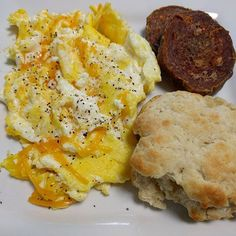 Scrambled eggs and cheese, smoked sausage, and a carbquik biscuit for #breakfast