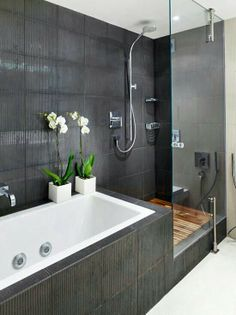 I like how streamlined this small bathroom looks. The dark grey and white colors coordinates seamlessly and this is also a nice contemporary look.