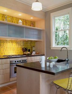 Cathy + Robin of Heath Ceramics' Kitchen with yellow heath ceramics tile backsplash #yellow #kitchen
