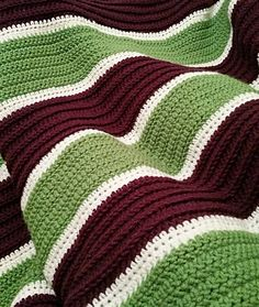 im_thinkingoutloud Ode to the Joker. Aubergine Fern white. Half double herringbone half double back loops only and half double crochet in between. A few more rows and my first blanket will be complete. Really excited about how this has turned out. Not bad for a first blanket and only learned to crochet 1 year ago.  #crochet #blanket #joker #villain #warm #creative #yarn #art #create #hamdmade #purple #green #color #stitch #first #proud #love #happy #instagood #instacrochet #yarnart #cozy…