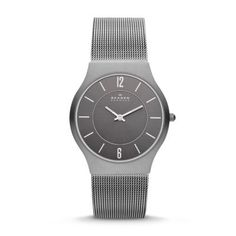 Grenen Men's Steel Mesh and Titanium Case Watch The Grenen Steel Mesh and Titanium Case Watch features a minimalist dial in a 34-mm case crafted of the lightweight, superstrong alloy. The wafer-thin 6.5-mm case lies flat on the wrist and houses an eye-catching cleanly designed face. Leading from it in an unbroken curve, the stainless steel mesh band suggests a shoreline carved out by ocean tides.