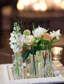 Simple and elegant Table Centerpiece - Mirror with different vases and flowers