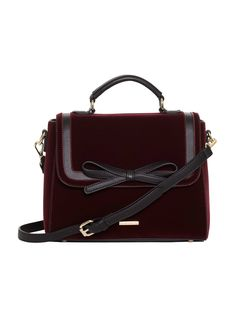 Embrace this season's hottest hue with the Bexley Bag in Wine. Luxurious velvet adorns this bag with contrast black trim and statement bow. The detachable shoulder strap offers stylish practicality, as does the magnetic press stud closure. Accessories Shop, Fashion Accessories, Purple Bags, Vintage Inspired Dresses, Occasion Wear, My Bags, Luggage Bags, Shopping Bag, Shoulder Strap