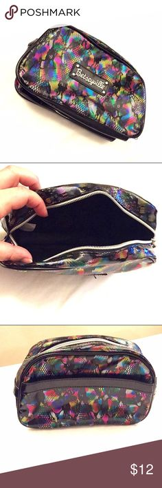 listing Betseyville Cosmetic Bag Betseyville medium sized makeup bag. Good condition. Iridescent rainbow with black lace print. Lightening bolt zipper pull. Betseyville Bags Cosmetic Bags & Cases