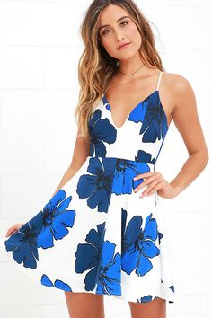 A stroll around town never felt better than in the Pretty Pop Blue and Ivory Floral Print Skater Dress! This darling, lightweight woven dress has a cobalt and navy floral print, thin straps, a curvy V neckline, and skater skirt. Exposed silver back zipper.