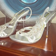 Celeste rhinestone shoes. Silver prom or party shoes. A few scratches on the heal and side.  Very minor.  3.5 inches heels. Celeste Shoes Sandals