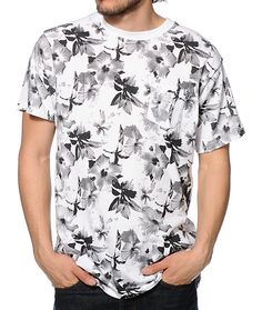 An all-over black and white floral print graphic provides a fresh look with a HUF brand tag at the left chest pocket and a tagless design to improve comfort.