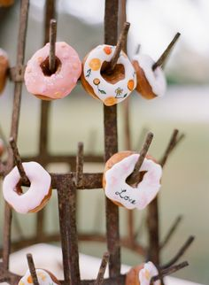 Hand-Painted Doughnuts with Orange Citrus and Love Quotes on Stand for Wedding Dessert Table   Wedding Cake Alternatives