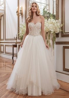 Beaded venice lace and tulle ball gown accentuated by a sweetheart neckline.