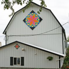 Barn Quilts: I love the colors in this one because they are very non-traditional. Not really what you'd expect on a barn quilt!
