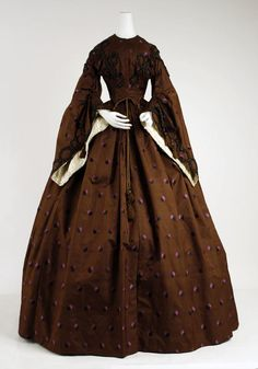 1858-1960 dress. Huge sleeves! Wear with very large under sleeves. Silk jacquard with woven pink and brown leaves, and trimmed with multicolored braided trim.
