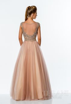 Two-tone tulle a-line ball gown featuring a mesh, bateau neckline, sequin embellished bodice and cap sleeves, and full, layered mesh skirt.