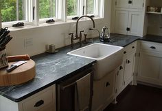 PROS AND CONS OF SOAPSTONE KITCHEN COUNTERTOPS   Dark soapstone counters, white farmhouse sink   Kitchen Cabinet Kings