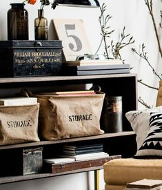 The burlap baskets used as storage provide a urban, industrial style within the shelving unit providing the room with a more relaxed, urban ambience.