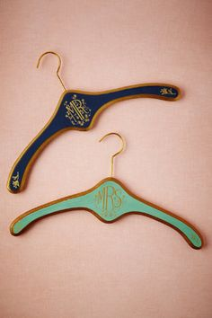 <p>In complementary shades of blue, these handsome hangers offer a clever twist to traditional dressing room photos.</p> <p>Exclusive to BHLDN<br /> 8.5″H, 18″W<br /> Wood, iron<br /> Imported</p>