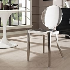 Carson Side Chair - Made of polished stainless steel, the Carson is sturdy and elegant. Suitable for indoor and outdoor use and they are stackable!