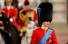 Prince William today made his debut on parade in Trooping the Colour - watched by his wife Kate.