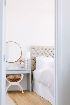 5 Tips for Mastering a Perfect White Bedroom// Kristin Kerr, tufted headboard, round mirror, fur stool. Love the dressing table / stool. Home Interior, Interior Design, Interior Ideas, Suites, White Bedroom, White Bedding, Parisian Bedroom, Feminine Bedroom, Neutral Bedding