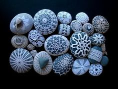 knitted and crocheted rocks, so elegant, they remind me of the beach.