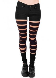 Black Women's skinny fit jeans Zip fly 5 pockets Slits on front The Super Slit Jeans from Tripp NYC are a bold, punk style. Super skinny, these jeans have slits all the way down the front of the legs. If you're style savvy you'll think of endless ways to wear them. Grab a pair of tights and layer up for even more punk attitude!