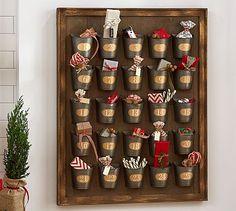 "Gilt Galvanized Advent Calendar PotteryBarn - 27"" Long X 3"" Wide X 34"" High. Pine Frame With A Hand-Painted Gold Gilt Finish. Twenty Five Galvanized Sheet Metal Cups."