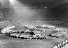 Germany Third Reich Dress rehearsal for the solstice festival at the Olympic Stadium, Berlin; 2500 SA men form a sun wheel around a heap of wood - Get premium, high resolution news photos at Getty Images German Soldiers Ww2, German Army, Welthauptstadt Germania, Nuremberg Rally, Solstice Festival, Iraqi Army, Berlin Photos, Nazi Propaganda, Germany Ww2