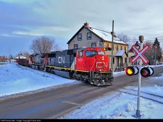 Heading toward Montreal, Canadian National #323 crosses Mercier St as it rolls through the city at sunset.