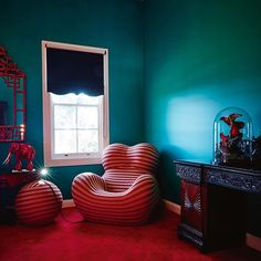 INTERIORS: In the guest room of artist Dale Frank's home, a clash of Anglo-Indian colonialism and Italian Modernism; Gaetano Pesce's 'Up 5' chair and ottoman (1969) for B&B Italia; teal blue walls custom-coloured by Dale Frank. By Annemarie Kiely by @hug
