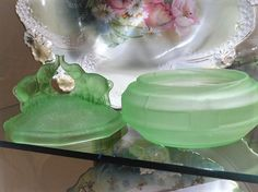 ITEM #RA-10  This is a rare and hard to find double kissing/battling elephants Art Deco green satin vaseline depression glass powder jar made circa 1930s by the LE Smith Glass Co.  Jar measures approx 5 in diameter and is 4 1/2 tall.  Condition: Very good antique condition with typical wear due to age and handling. No chips, cracks etc. There are a couple of straw marks on the inside rim of the base as was typical with this type of glass.   To find more great antique and vintage ite...