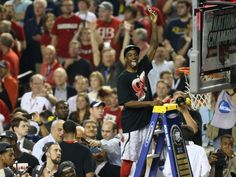 Louisville Cardinals guard Russ Smith celebrates during the net cutting ceremony .
