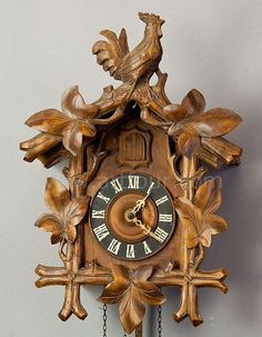 black forest carved wood cuckoo clock with cock on top