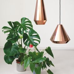 Thin copper sheets have been folded to create this constructed copper lamp.