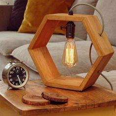 You can make this attractive wooden lamp in which we have placed the lamp upside down. We have used open wiring for this project. You can put it on your center table to beautify it or can use it in your bedrooms.
