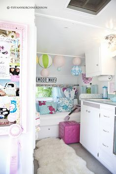 The inside of the little camper. socutecanthandleit! (not my home idea) but still adorable:)