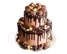 """Jen, Bake down cakery. """"Up-close and personal to this Ferrero, salted caramel small two-tier cake! Hope everyone has had a great weekend! Onto the new week! Chocolate Drip Cake, Artisan Chocolate, Chocolate Chip Muffins, Chocolate Ganache, Ganache Cake, Nutella Cake, Hazelnut Cake, Chocolate Cream, Chocolate Desserts"""
