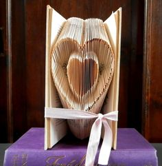 This Folded Book Art is a perfect gift to give for Valentine's Day! After searching for a while i found this website that offers patterns, this was one of their ...