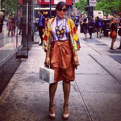 I love any #vintagekimono especially a #vintagesilkkimono .A #kimono is perfect as a light #falljacket for your own interpretation of #fallfashion .Me in a #vintagejapanesekimono in a playful, #colorfulprint , (#japaneseillustration) over a #geometricprint #stripedsilk top & #vintagepolka skirt /#silkpolkaskirt  in #orange & #blackpolka, w/ #charlesdavid #graypatentwedges . Accessories: #vintagebakelite #statementnecklace (colorful #polka #bakelitenecklace) & #vintagelucitebag.