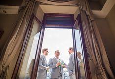 Destination Wedding Photographer Catherine Bradley Grand Hotel Tremezzo Lake Como Italy Pre Drinks Groom and Groomsmen