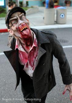 "HHN 22, Universal Studios Florida    A dapper-looking member of Halloween Horror Nights 22′s ""Dark Legions – Vampires"" bares his chompers for the camera.    Photo byBryan Frank."