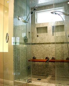 This walk-in shower is not only fitted with double shower heads, recessed storage areas and seating, but it's also controlled by an electronic dial that sets temperature and other programmable controls.    The luxuries continue outside the shower as well, as a heated shower awaits those stepping out onto the tile floor.
