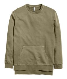 Long top in washed cotton sweatshirt fabric with a pocket at the front, raw edges around the hem and cuffs, and slits in the sides. Slightly longer at the back.