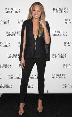 Chrissy Teigen from Stars at New York Fashion Week Fall 2015  The model stuns in a plunging caped top at the Badgley Mischka presentation.