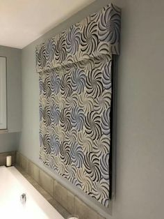 Blue and grey embroidered linen roman blind with a pattern matched pelmet. Redhead Interiors for Gilly Henson Designs