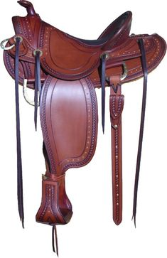 Elegant border stamping and extensive spot work make this saddle stand out. Price includes my famous centered seat, inlaid pad, full spotwork, matching stirrups and your choice of seat size and gullet width. $3300