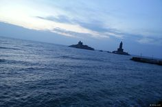 An early morning view of the Vivekananda Rock Memorial and Thiruvalluvar Statue as viewed from the Sunrise point at Kanyakumari, the southernmost tip of mainland India.    The rock islet to the left is called Sri Padhaparai, where one can see the footprints of the Goddess Kanyakumari. Swami Vivekananda swam to this rock across the ocean and deeply meditated here for three days, about the past, present and future of India, and attained enlightenment.