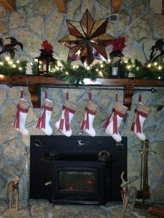 My fireplace mantel decorated with lanterns and garland