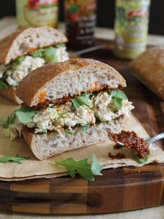 Garlic yogurt chicken salad sandwich with sun dried tomato spread.